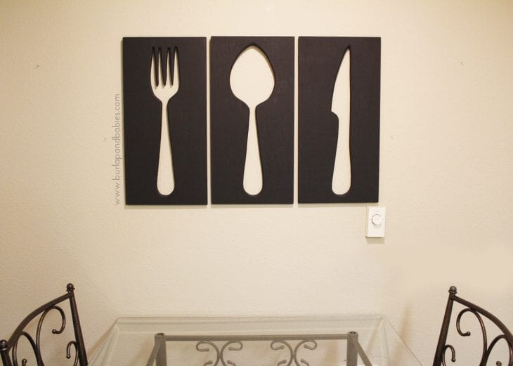 Large wall art of fork, spoon, and knife wood cutouts image.