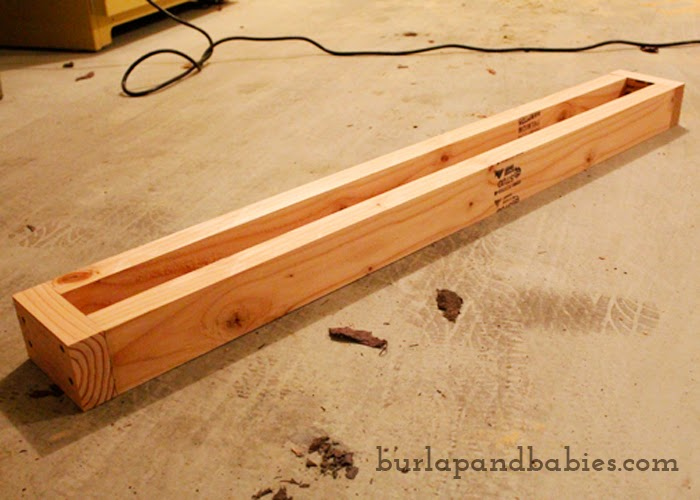 Unfinished wooden rectangle box image.