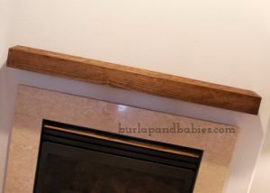 DIY wooden box placed on wall above fireplace image.