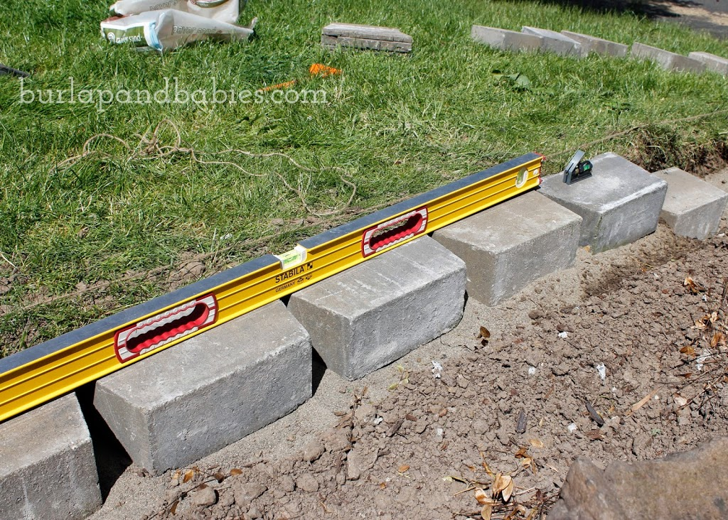 How to Build a Retaining Wall / Up your curb appeal by building a retaining wall to make a drastic change quickly. You can do it this weekend without needing professionals!