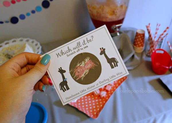 Hand holding gender reveal ticket image.