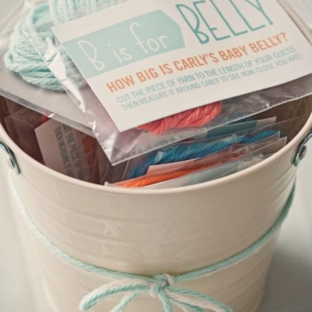 Pail with baby shower game inside image.