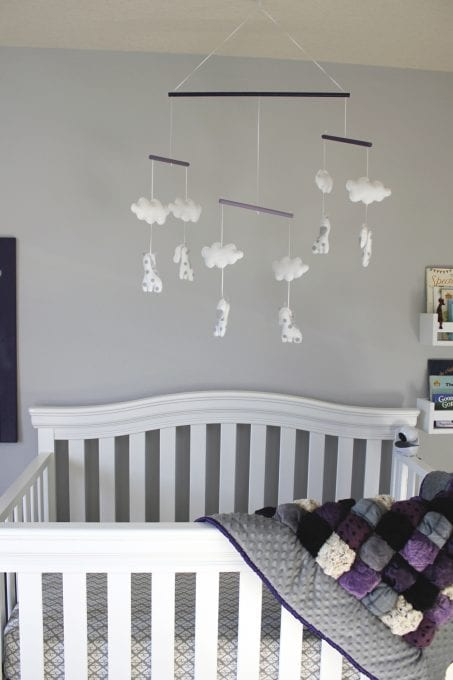 Crib with a mobile overhead image.