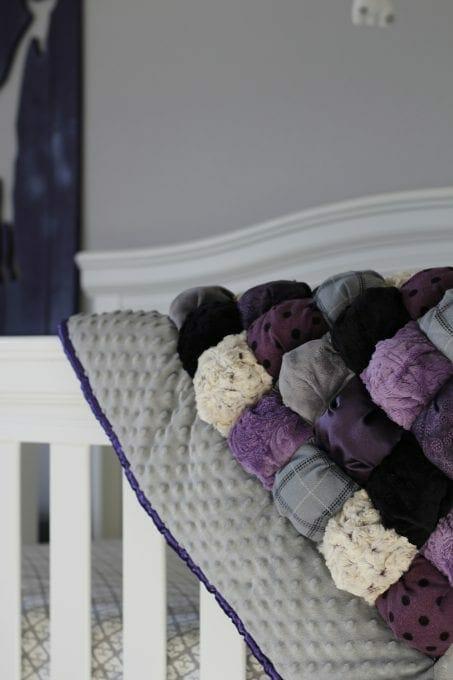 Handmade purple baby quilt image.