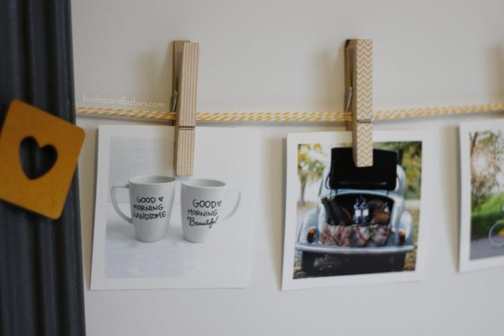 Photos displayed on a rope with clothespins image.