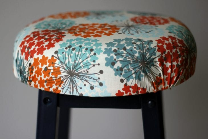 Barstool with printed fabric seat image.