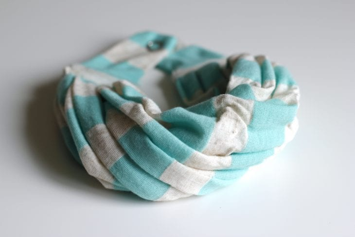 Tiny blue and white infinity scarf made for a baby image.