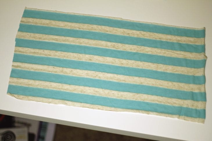 Blue striped fabric rectangle image.