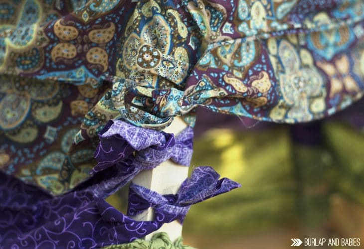 Scraps of brightly colored fabric tied to wood image.