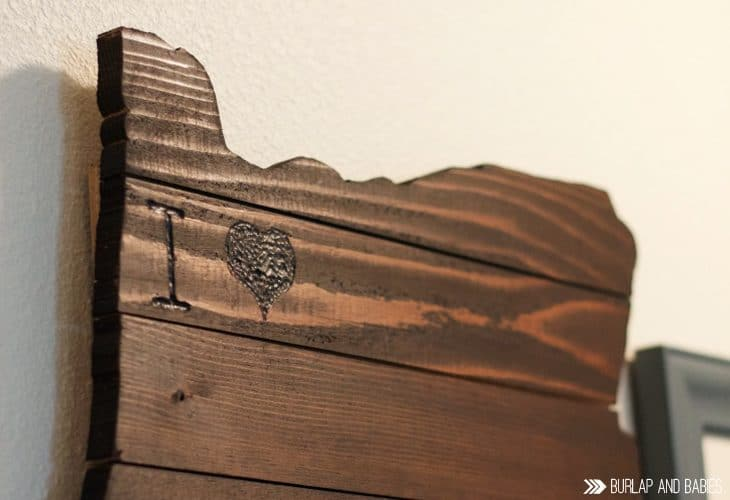 Wooden wall art in the shape of a state image.