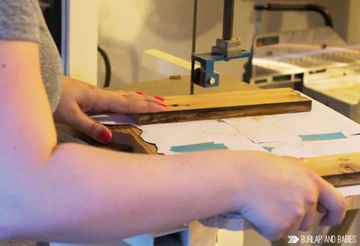 Woman sawing wood image.