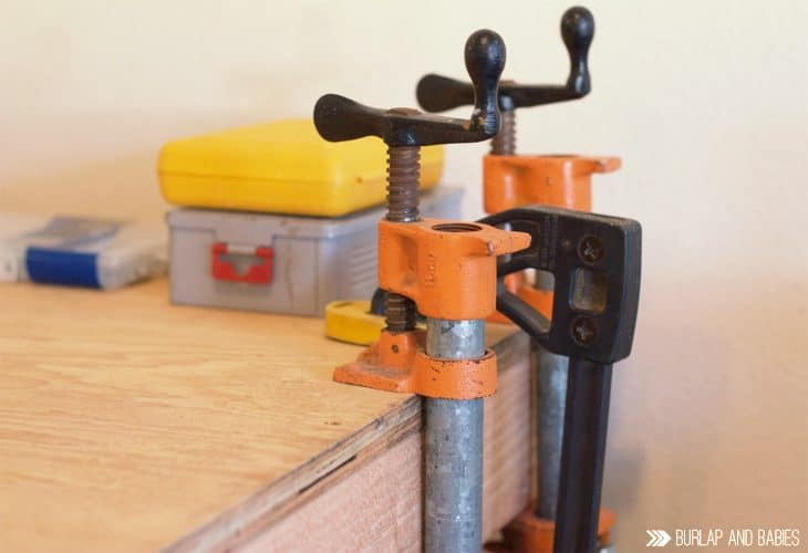 Vice grips on wood of the rolling workbench image.