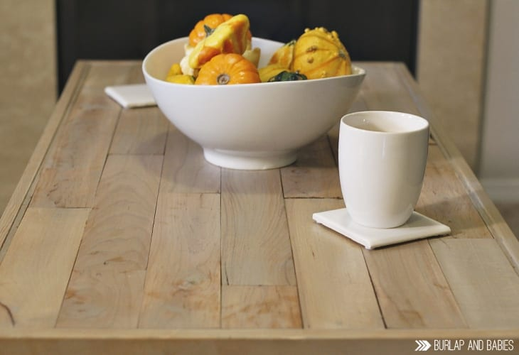World Market Coffee Table Makeover | A nice blend where farmhouse meets industrial. Use an old pallet, some paint, and stain to create a custom gorgeous coffee table to fit your style! Get the World Market look without the World Market price!