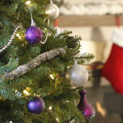 A Silver & Purple Glam Christmas Tree with glittery ornaments with a twist of rustic burlap.