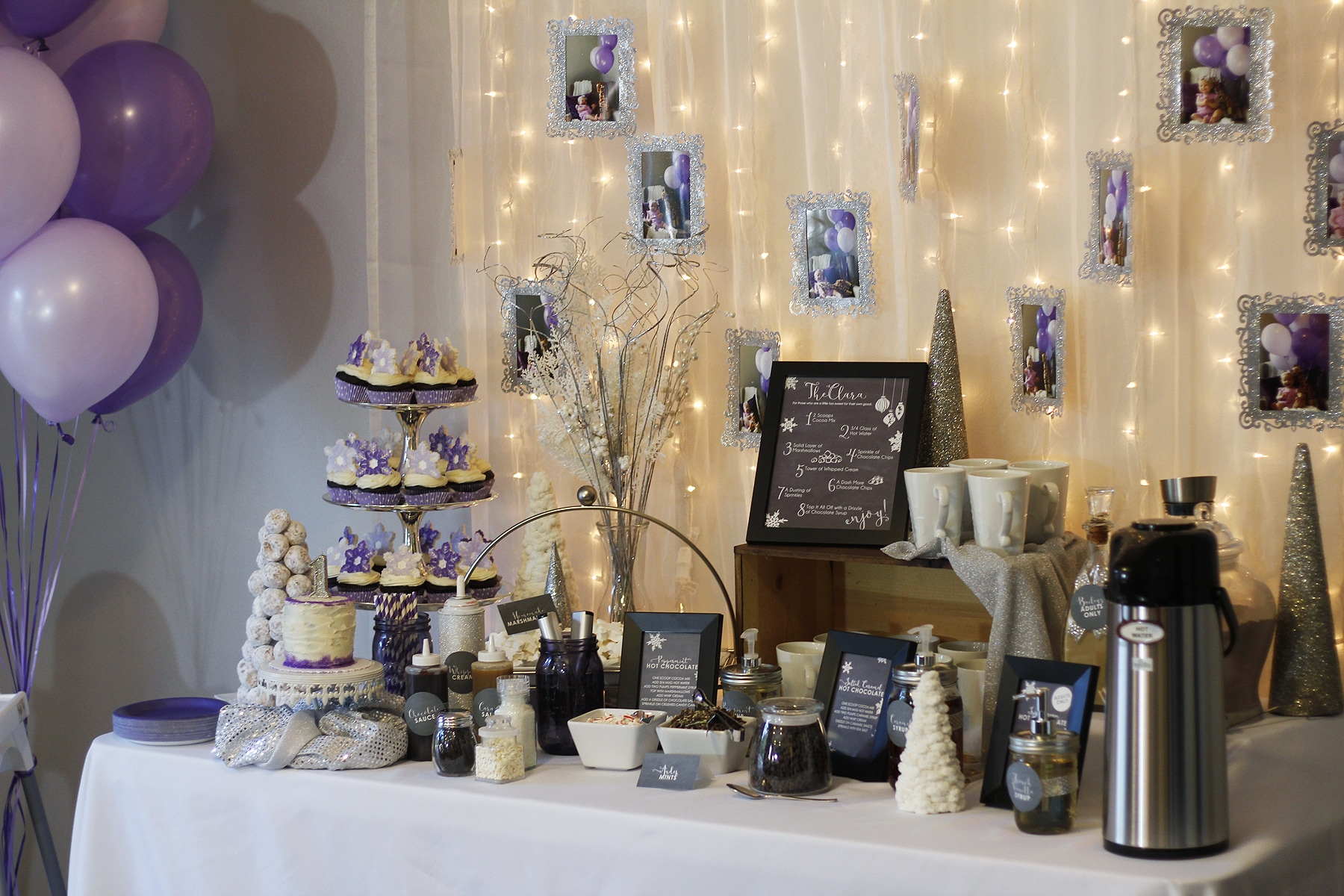 Winter Wonderland Hot Chocolate Bar with DIY frames hung over twinkly lights image.