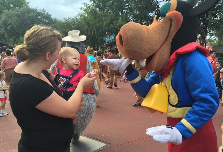 Mom and baby meeting a Disney character image.