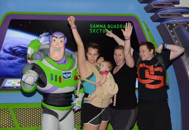 Family in front of Buzz Light Year statue image.