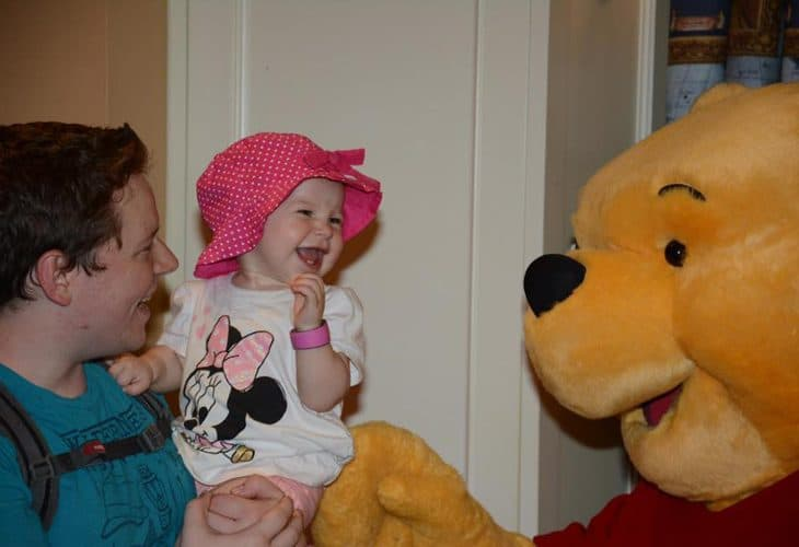 Dad, little girl and Winnie the Pooh image.