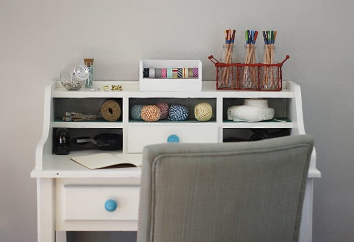White desk with blue knobs.