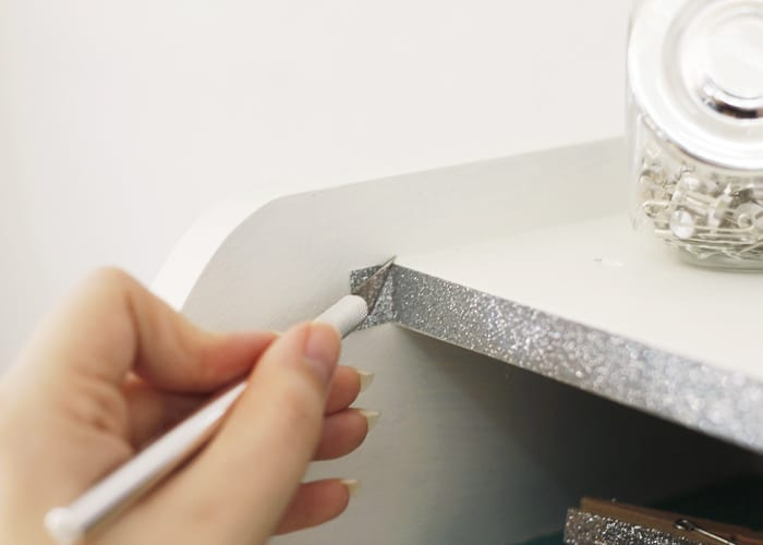 Hand cutting washi tape with exacto knife image.
