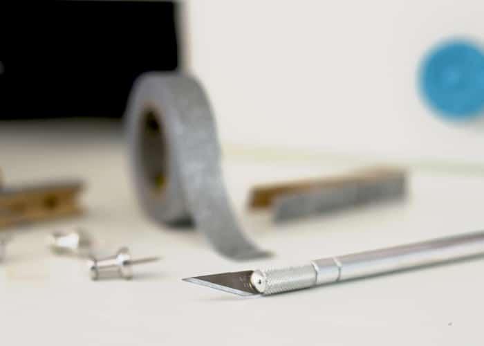 Exacto knife and washi tape image.