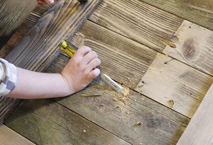 Chiseling the wood image.