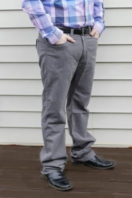 Man wearing gray pants with hands in pocket image.