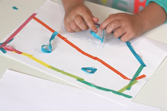 Little hands playing with washi tape image.