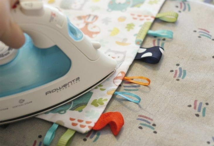 Ironing a DIY tag blanket image.