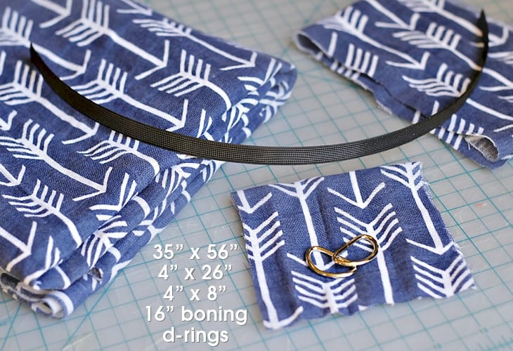 Blue fabric with white accents, d-rings and boning image.