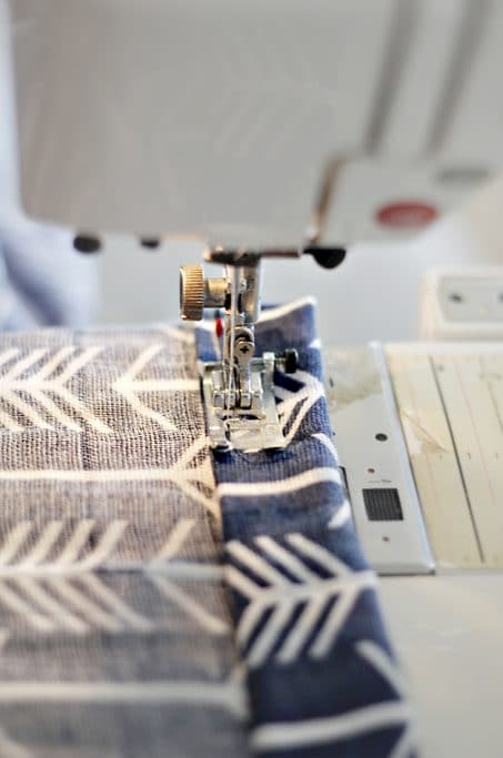 Sewing machine sewing fabric image.