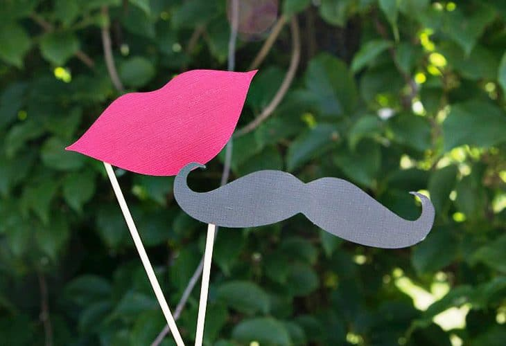 Host a beautiful backyard bridal shower full of lots of DIY ideas, decorations, finger food recipes, and fun games. This lips and mustaches were the perfect addition to the