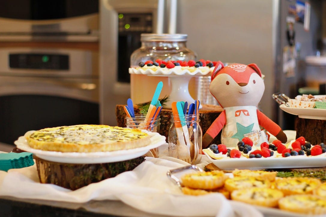Food buffet with stuffed fox and painted wooden sticks in coordinating colors image.