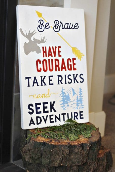 """White canvas with the words, """"Be brave, have courage, take risks, and seek adventure"""" image."""