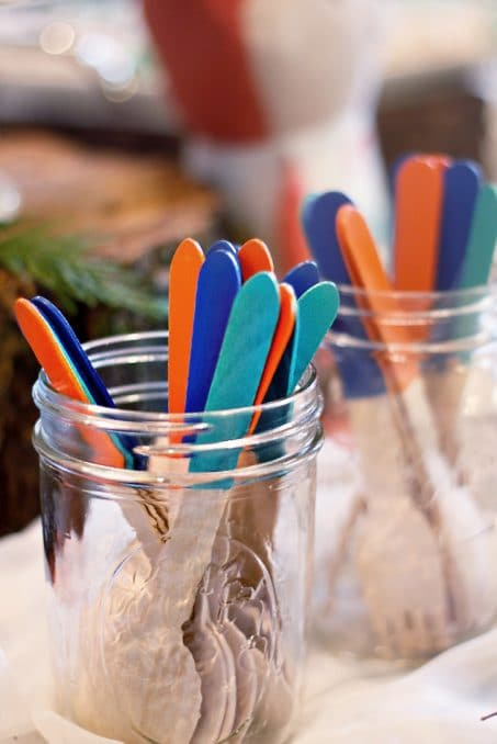 Wooden sticks dipped in orange and shades of blue image.