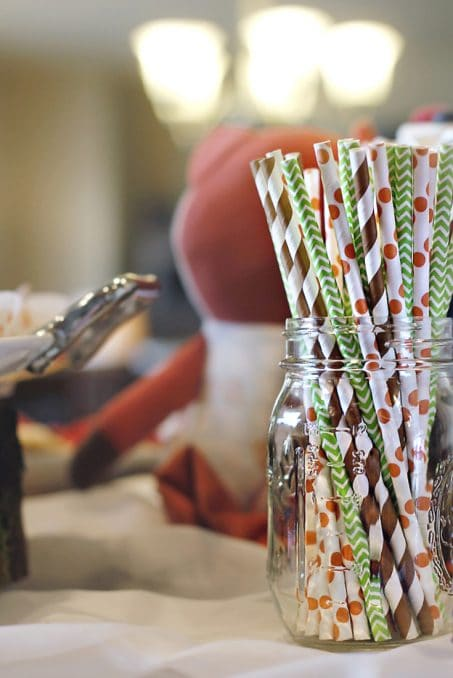 Colorful paper straws in a clear jar image.