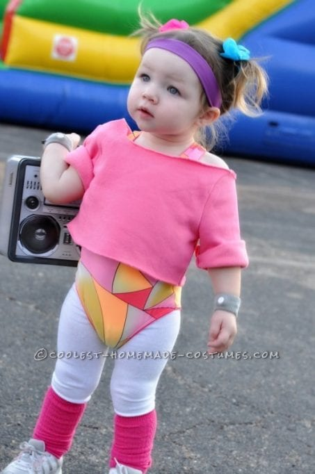 Little girl in 80s workout Halloween costume.