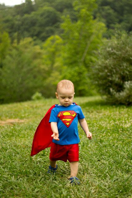 Little boy in DIY Superman costume image.