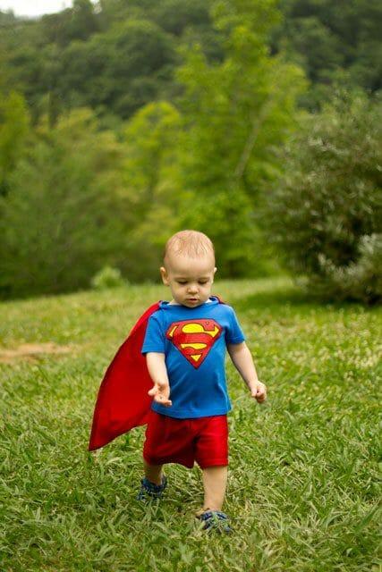 Little boy in DIY Superman costume image.