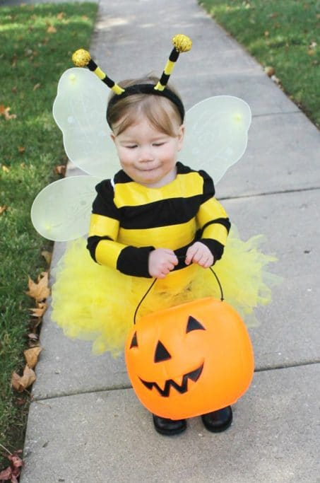 Little girl in DIY bee costume image.