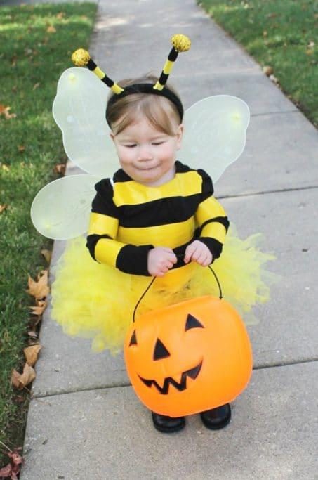 Little girl in DIY bee costume image.