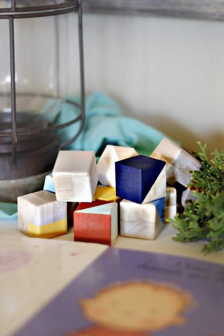 Make these easy DIY geometric wood blocks perfect as nursery decor or for baby shower decor.