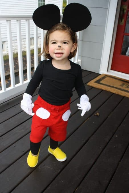 Little girl in Mickey Mouse costume image.
