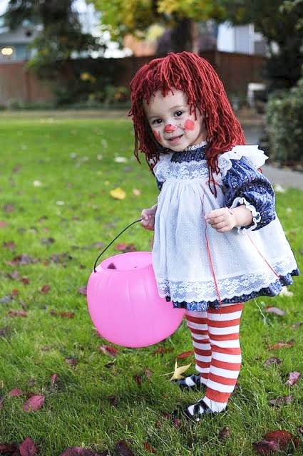 Little girl in DIY Raggedy Ann costume image.