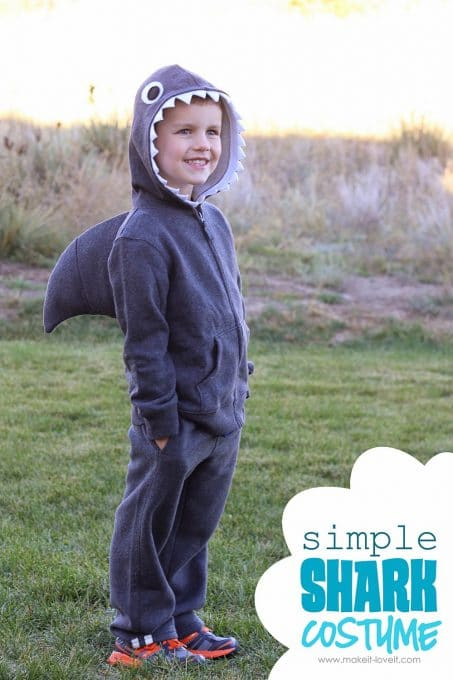Little boy in DIY shark costume image.