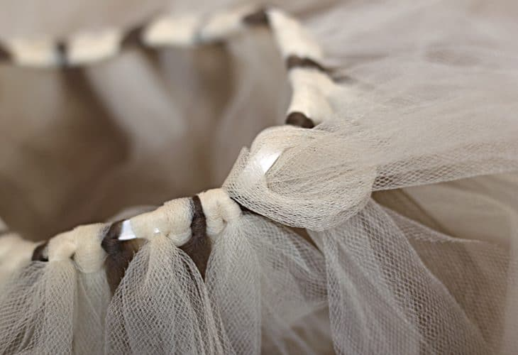 Tying tulle through elastic image.