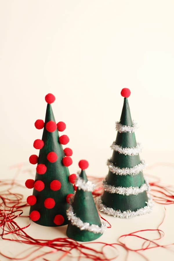 Red pom pom decorated mini Christmas trees image.