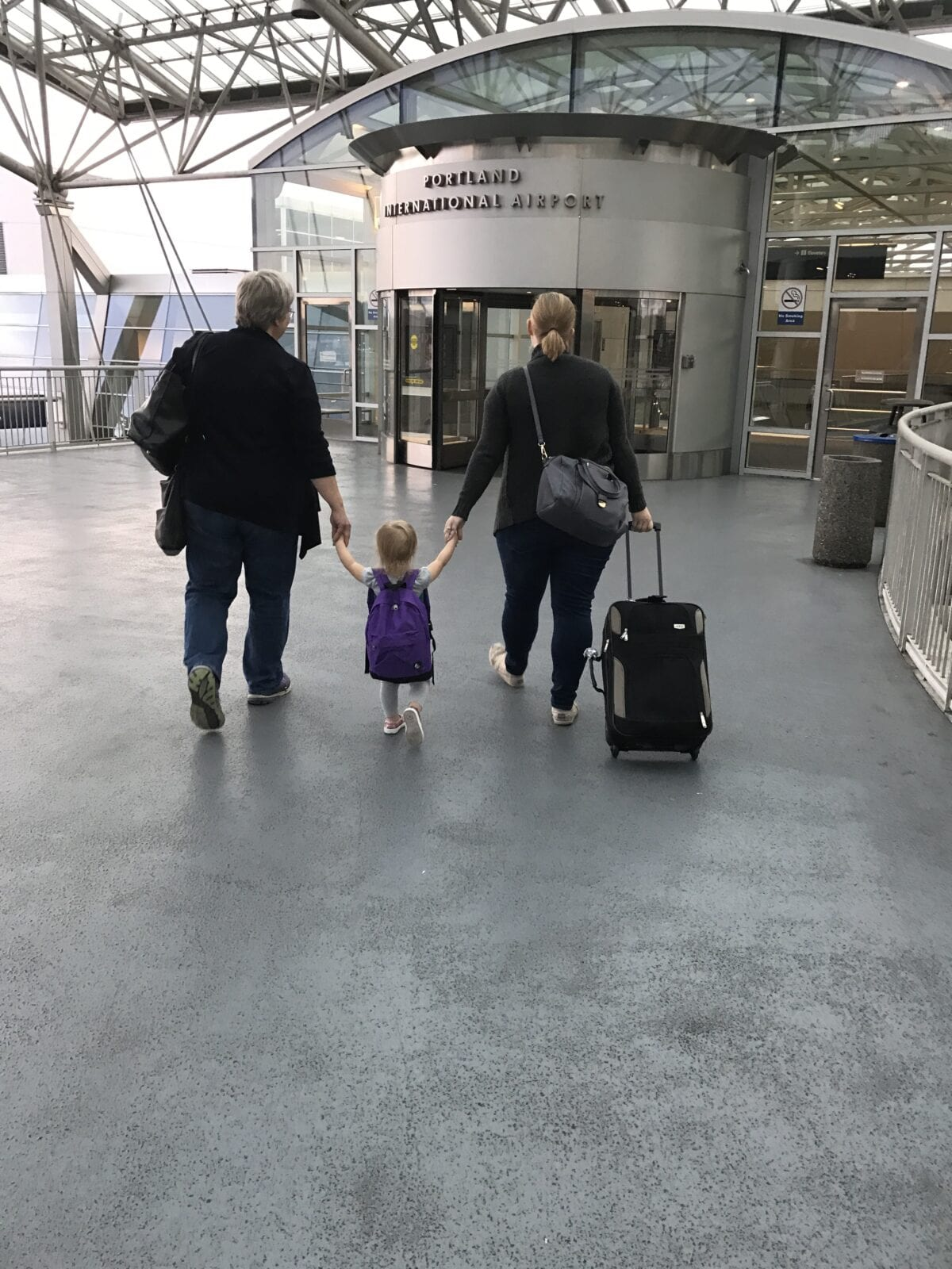 Family walking through airport image.