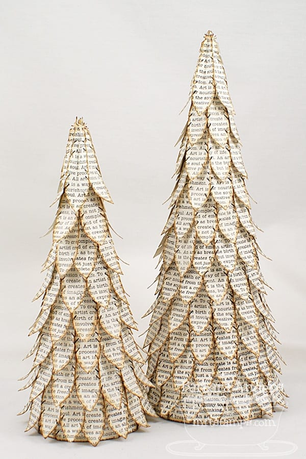 Book page mini Christmas trees image.