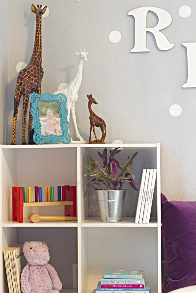 Little girl's bedroom with giraffes on top of a bookcase image.